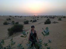 Alyssa J. Montgomery in desert in Dubai
