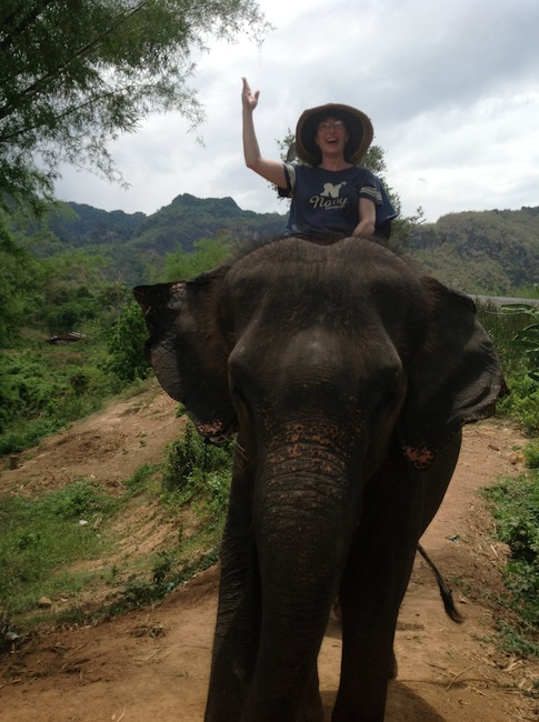 Alyssa J. Montgomery on elephant trail ride in Thailand